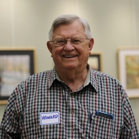 Photo of older gentleman smiling, at Senior Center event