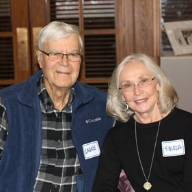 Photo of older couple smiling, at a Senior Center event